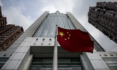 The Chinese national flag flies in front of the Liaison Office of the Central People's Government in Hong Kong on Wednesday. Lawmakers in Beijing are reviewing the election method of Hong Kong's chief executive and are expected to announce their decision on Sunday. Photo: AFP