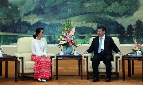 China's Xi meets Aung San Suu Kyi