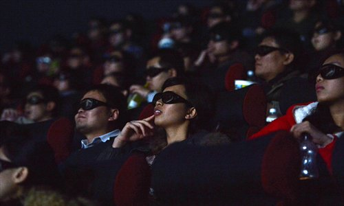 Movie-goers at a cinema in Shijiazhuang, Hebei Province, watch a 3D film. Photo: CFP
