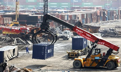 Cranes move away destroyed containers at core area of Tianjin blasts