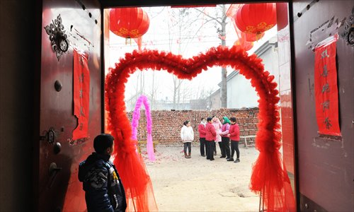 Family members await the start of the wedding in a village in Zouping county, Shandong Province. Photo: CFP