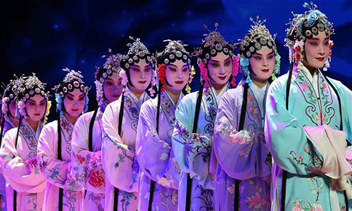 Artists perform during a performance showcasing traditional Chinese operas at a theater in Lima, Peru, Nov. 20, 2016. (Xinhua/Li Ming)