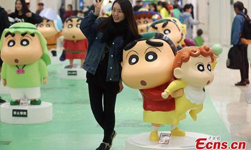 People visit the exhibition of Japanese manga series Crayon Shin-chan in Nanjing, East China's Jiangsu province on November 21, 2016. (Photo: China News Service/ Yang Bo)