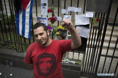 Residents mourn Fidel Castro outside Cuban Embassy in