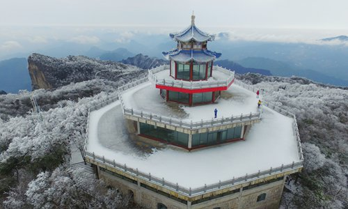 An aerial view of the rime-covered trees blanketing Tianmen Mountain in Zhangjiajie National Forest Park, Central China's Hunan Province, on November 24, 2016.(Photo:IC)