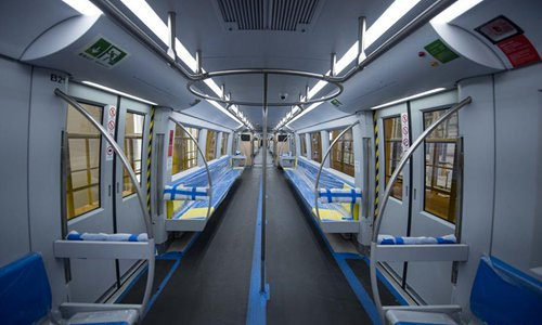Photo taken on Dec. 25, 2016 shows the interior of Beijing's first medium-low speed maglev Line S1 in Beijing, capital of China. The Line S1, which connects the city's western district of Mentougou to the Pingguoyuan subway station in Shijingshan district, is expected to begin operating in 2017. With a maximum speed of 100 kilometers per hour, the train will stop at eight stations and serve about 1,302 passengers at a time. (Xinhua/Luo Xiaoguang)