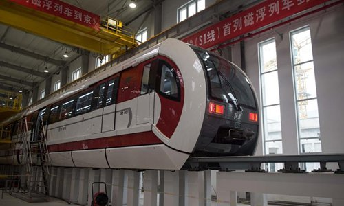 Photo taken on Dec. 25, 2016 shows Beijing's first medium-low speed maglev Line S1 in Beijing, capital of China. The Line S1, which connects the city's western district of Mentougou to the Pingguoyuan subway station in Shijingshan district, is expected to begin operating in 2017. With a maximum speed of 100 kilometers per hour, the train will stop at eight stations and serve about 1,302 passengers at a time. (Xinhua/Luo Xiaoguang)