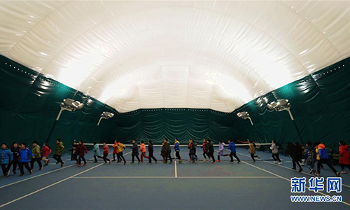 Students from the Huaxing Primary School in Shijiazhuang, capital of North China's Hebei Province, attend PE class in an indoor stadium to avoid smog some time in December 2016. Photo: Xinhua