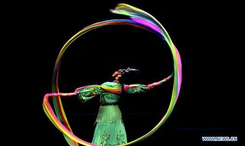 An artist of a traditional troupe from Jiande, east China's Zhejiang Province, performs Wuju opera at Al-Hussein Cultural center in Amman, capital of Jordan, on Jan. 19, 2017, to celebrate the upcoming Chinese Lunar New Year. (Xinhua/Mohammad Abu Ghosh)