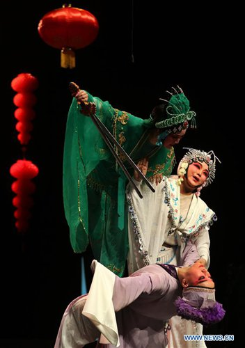 Artists of a traditional troupe from Jiande, east China's Zhejiang Province, perform Wuju opera at Al-Hussein Cultural center in Amman, capital of Jordan, on Jan. 19, 2017, to celebrate the upcoming Chinese Lunar New Year. (Xinhua/Mohammad Abu Ghosh)