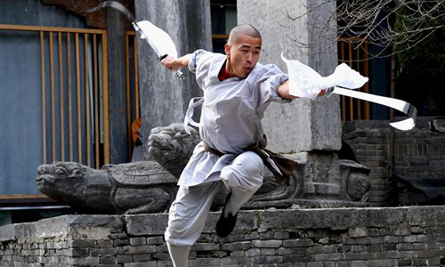 A monk practices martial arts at Shaolin Temple in central China's Henan Province, Jan. 21, 2017. Photo:Xinhua