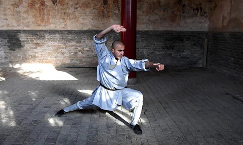 An Indian monk practices martial arts at Shaolin Temple in central China's Henan Province, Jan. 21, 2017. Shaolin Temple is located at Songshan Mountain in Henan. Photo:Xinhua