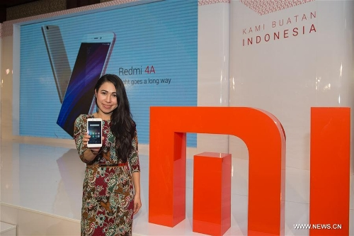 Chinas xiaomi releases new smart phone in indonesia global times a mi fan shows a newly released smart phone redmi 4a which is the first type of smart phone of xiaomi made in indonesia in jakarta capital of indonesia stopboris Choice Image