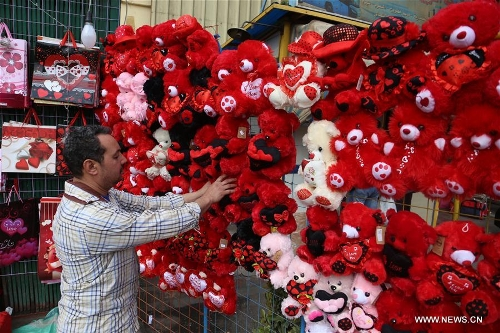 A vendor arranges gifts at his flower shop on the Valentine's day in Cairo, Egypt on Feb. 14, 2017.(Xinhua/Ahmed Gomaa)