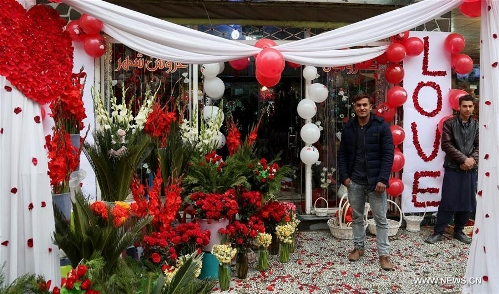 Afghan men wait for customers at a flower shop on Valentine's Day in Kabul, capital of Afghanistan, Feb. 14, 2017. (Xinhua/Rahmat Alizadah)