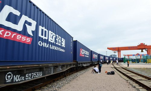 Photo taken on Sept. 9, 2017 shows a Chinese Railway Express cargo train leaving for Prague, the Czech Republic, from Yiwu, east China's Zhejiang Province. The train, loaded with 88 containers of cloth, clothing, shoes, hats and Christmas items, will pass through Kazakhstan, Russia, Belarus, and Poland and travel about 16 days before arriving in Prague. The journey is about half the time for traditional sea voyage. According to customs statistics, imports and exports via Yiwu's Sino-Europe freight service have grown rapidly, reaching 3 billion yuan in 2016.Photo:Xinhua