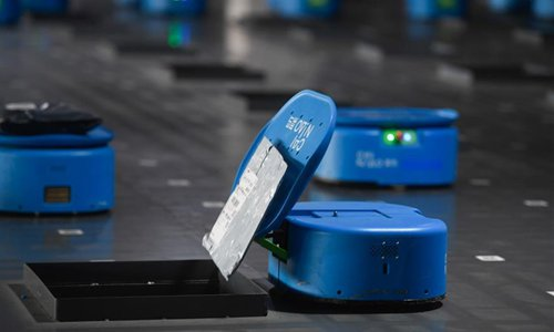Robots distribute packages at logistics center in Hangzhou, China's Zhejiang