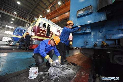 Railway staff work at locomotive maintenance center in Ulanqab, N China's Inner Mongolia