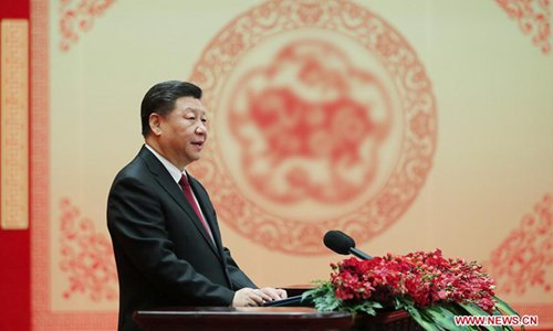 Xi extends Spring Festival greetings, expressing confidence for future