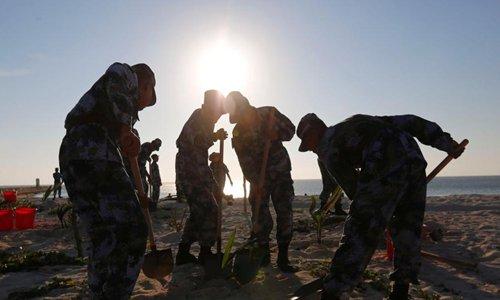 Soldiers transform barren Zhongjian Island - Global Times
