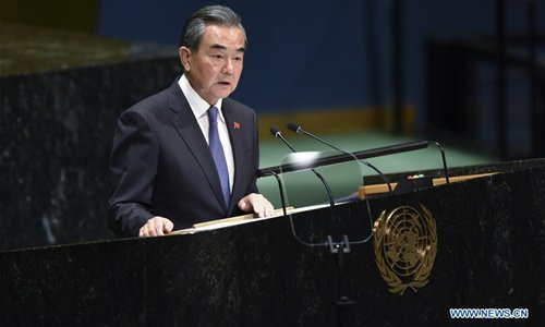 China against abuse of power, will never yield to pressure: FM