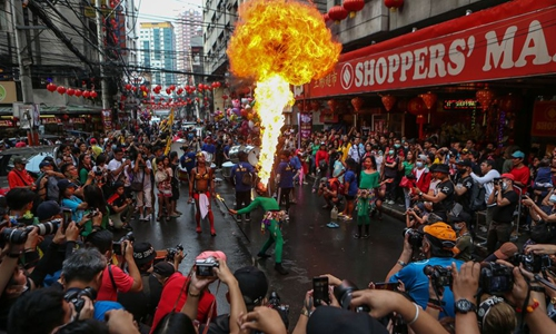 fire breathers perform during chinese new year celebrations in philippines global times fire breathers perform during chinese