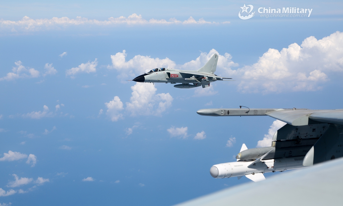 Fighter bombers attached to a naval aviation brigade under the PLA Northern Theater Command fly in line formation during a recent combat readiness patrol recently.Photo:China Military