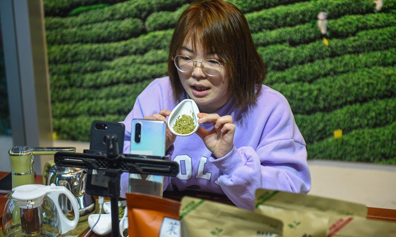 Ye Yuzhu introduces tea to the audience via livestreaming at the tea market in Songyang County of Lishui City, east China's Zhejiang Province, Feb. 25, 2021.(Photo: Xinhua)