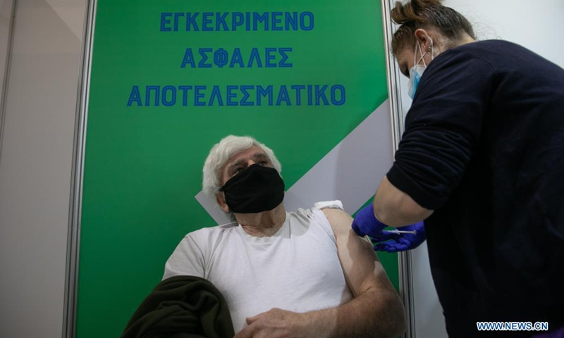 A man receives the COVID-19 vaccine at a vaccination center in Athens, Greece, on April 2, 2021. Greece will continue to administer AstraZeneca's COVID-19 vaccine despite the decision by some other European Union (EU) countries to suspend its use for certain age groups, Greek officials said on Friday. (Photo by Lefteris Partsalis/Xinhua)