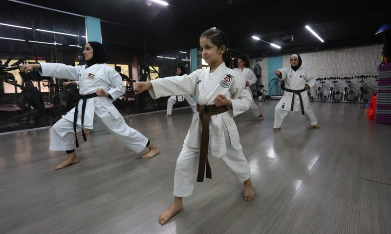 Members of Palestinian Bsharat family practice karate at a local gymnasium in the West Bank city of Nablus, on April 4, 2021.(Photo: Xinhua)