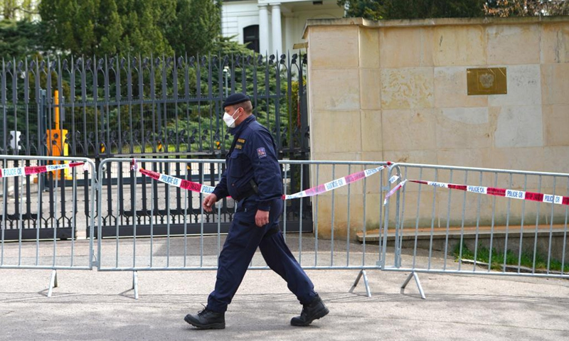 A Czech policeman is seen outside the Russian embassy in Prague, the Czech Republic, on April 22, 2021. The Czech Republic will reduce and put a cap on the number of employees in the Russian embassy in Prague to the same number at the Czech embassy in Moscow, the Czech Foreign Ministry said on Thursday.Photo:Xinhua
