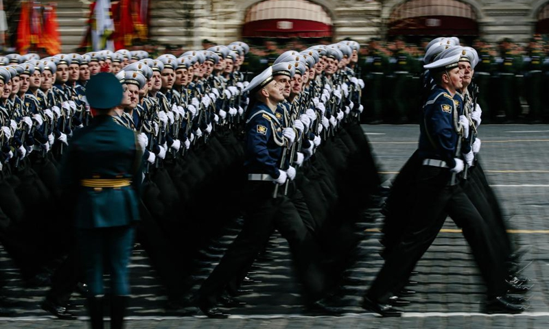 Servicemen march during a rehearsal of the Victory Day parade in Moscow, Russia, May 7, 2021. Russia will hold military parades across the country to commemorate the 76th anniversary of the Soviet victory in the Great Patriotic War on May 9. Photo:Xinhua