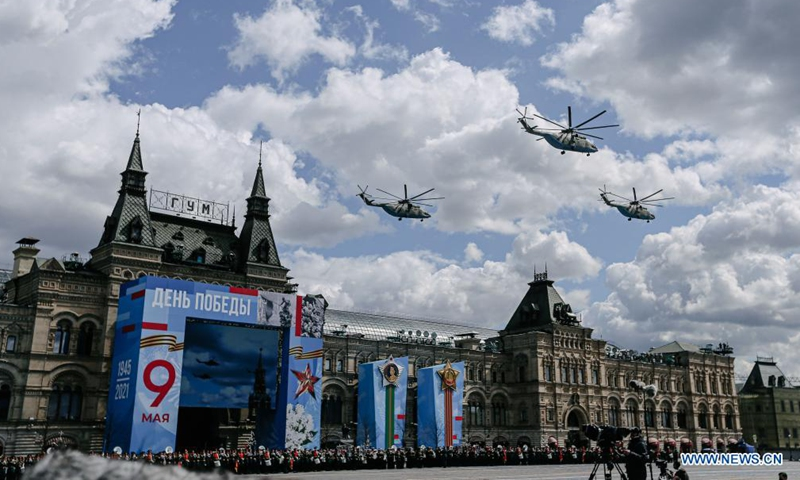 Helicopters fly over the Red Square during a rehearsal of the Victory Day parade in Moscow, Russia, May 7, 2021. Russia will hold military parades across the country to commemorate the 76th anniversary of the Soviet victory in the Great Patriotic War on May 9.Photo:Xinhua