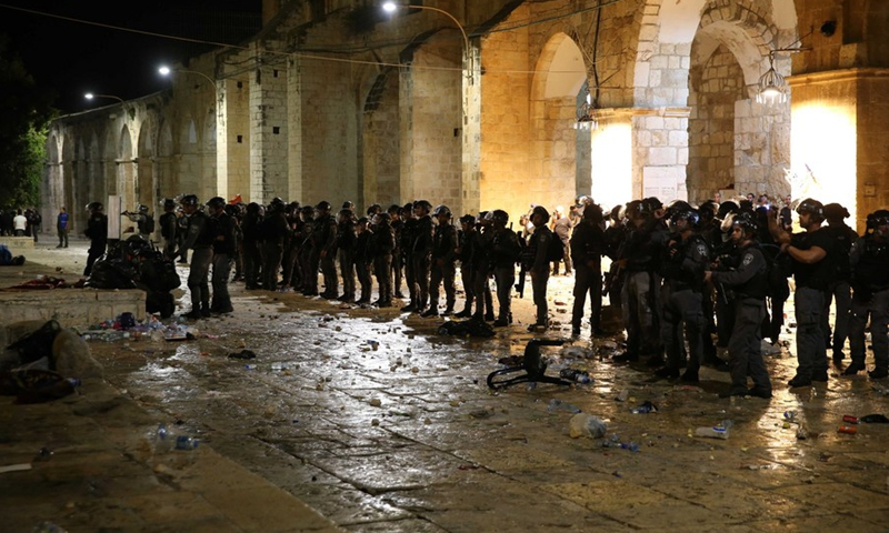 Israeli police are seen during clashes at the Al-Aqsa Mosque compound in East Jerusalem, on May 7, 2021.(Photo: Xinhua)