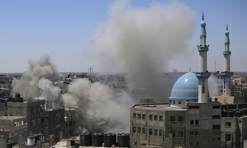 Smoke billows following an Israeli airstrike on a house are seen in the southern Gaza Strip city of Rafah, May 15, 2021.(Photo: Xinhua)