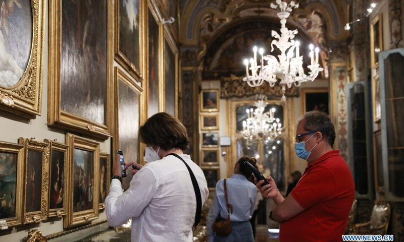 Visitors view exhibits at the Doria Pamphilj Gallery in Rome, Italy, May 21, 2021. As Italy began easing coronavirus health restrictions, many sites including the Doria Pamphilj Gallery have reopened to visitors, with a series of precautions being taken, such as limiting number of visitors and requiring visitors to reserve precise entry times.Photo:Xinhua