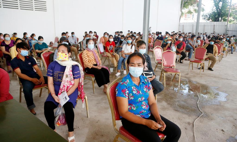 People wait to receive China's Sinovac COVID-19 vaccine at a vaccination site in Phnom Penh, Cambodia on June 1, 2021. (Photo: Xinhua)