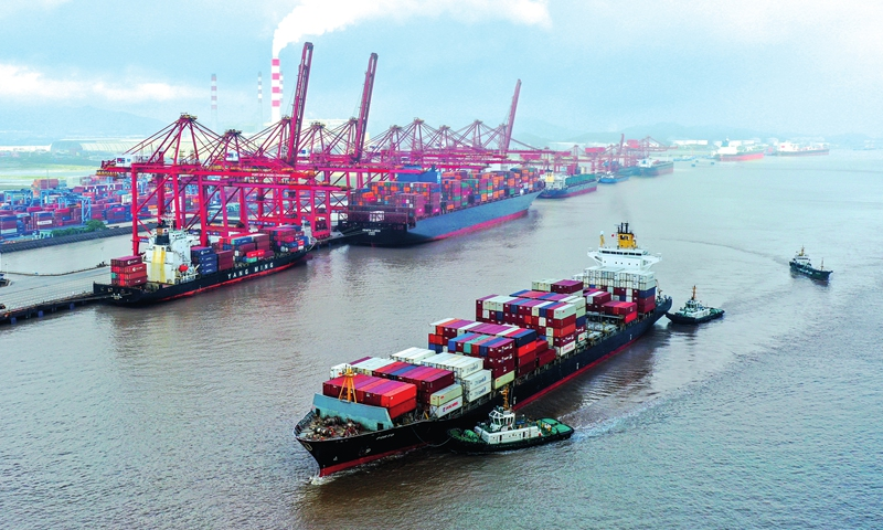 Cargo ships carrying containers pile up at the Ningbo Zhoushan Port in Ningbo, East China's Zhejiang Province on Tuesday. The boom in container throughput for foreign trade comes as the country's yuan-denominated exports jumped 30.1 percent year-on-year in the first five months, customs data showed Monday. Photo: cnsphoto
