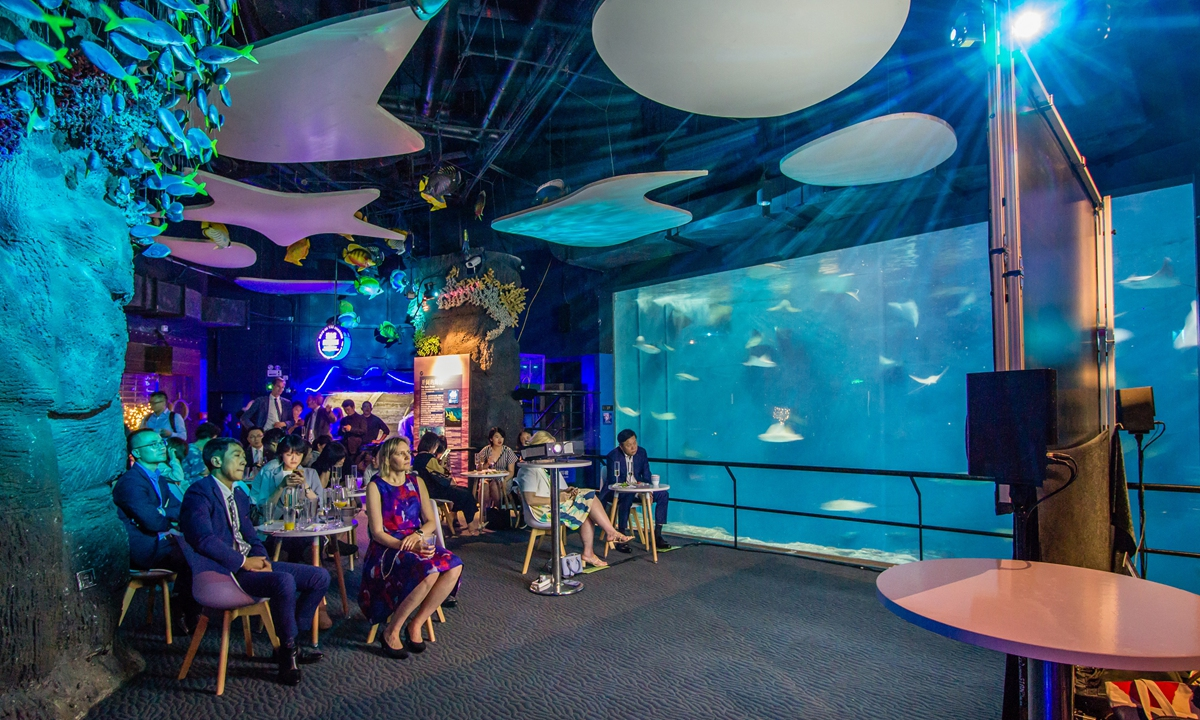 People participate in the event at Shanghai Ocean Aquarium on Tuesday night. Photo: Courtesy of Consulate General of Norway in Shanghai