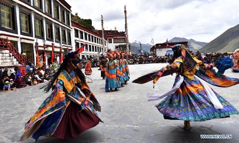 Buddhist monks perform Cham dance at the Drigung Monastery in Lhasa, southwest China's Tibet Autonomous Region, June 9, 2021. Cham dance is a masked and costumed ritual performed by Tibetan Buddhist monks.  Photo: Xinhua
