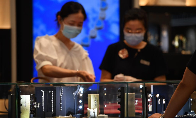 Customers choose products at a duty-free shopping mall in Haikou, south China's Hainan Province, July 2, 2021. Official data shows that offshore duty-free sales in the province grew 226 percent between July 1, 2020 and June 30, 2021, reaching 46.8 billion yuan (about 7.2 billion U.S. dollars). Meanwhile, about 60.72 million items were sold to some 6.28 million customers.Photo:Xinhua