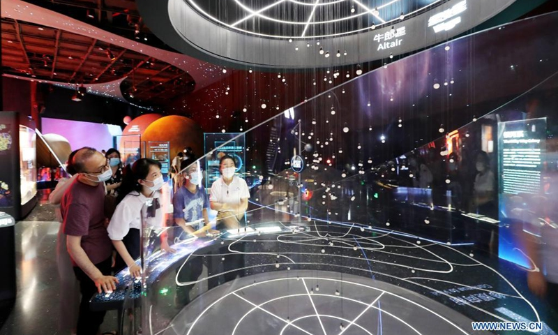 Visitors look at exhibits in Shanghai Astronomy Museum during a media preview in east China's Shanghai, July 5, 2021. The Shanghai Astronomy Museum, the world's largest planetarium in terms of building scale, will open on July 17, the planetarium announced Monday. The museum is located in the China (Shanghai) Pilot Free Trade Zone Lingang Special Area. It is a branch of the Shanghai Science and Technology Museum.(Photo: Xinhua)