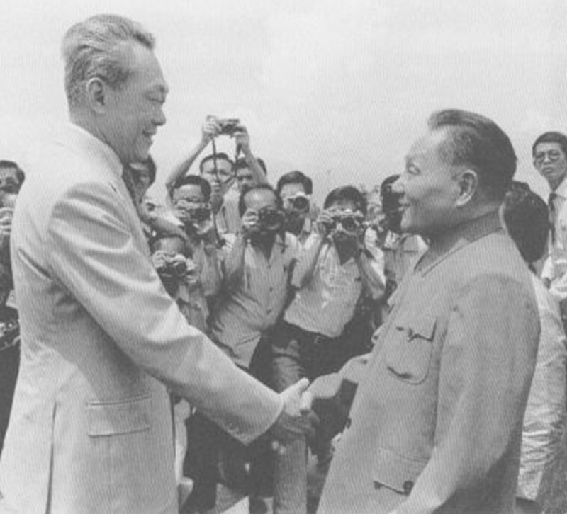 Deng Xiaoping shaking hands with Prime Minister Lee Kuan Yew at the airport during his visit to Singapore, November 1978