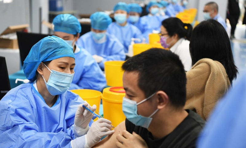 People receive COVID-19 vaccination at a temporary vaccination site in Jiangbei District of Chongqing, southwest China, April 8, 2021.Photo:Xinhua