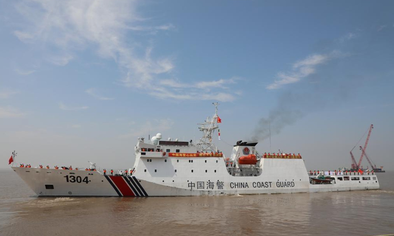 A China Coast Guard ship on a fisheries law enforcement mission in the North Pacific Ocean sets sail from Shanghai, east China, on July 30, 2021. Two coast guard ships dispatched by the China Coast Guard (CCG) departed from Shanghai on Friday for the North Pacific Ocean to enforce fisheries law. The two vessels will cruise on the high seas of the North Pacific Ocean during a 31-day patrol, according to the CCG. Photo:Xinhua