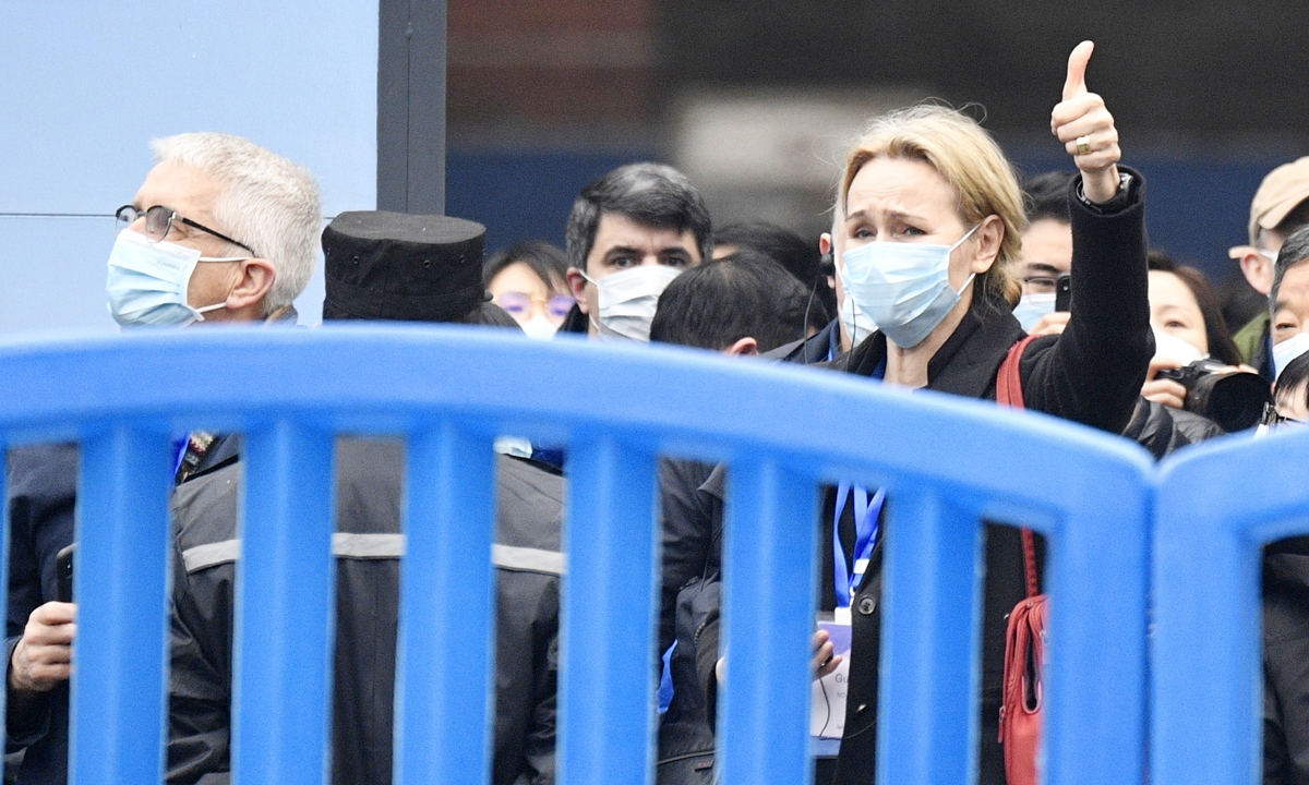 A member of the WHO-China joint team studying?the origins of the coronavirus gives a thumbs-up in front of cameras in Wuhan, Central China's Hubei Province, on January 31. Photo: IC