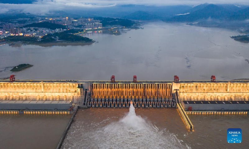 Aerial photo taken on Sept. 6, 2021 shows a view of the Three Gorges Dam in central China's Hubei Province. Chinese authorities have called for rigorous anti-flooding measures along the Yangtze River as water levels continue to rise following heavy rainfall, the Ministry of Water Resources said on Monday. The flow of water at the Three Gorges reservoir has increased rapidly, reaching 54,000 cubic meters per second as of 2 p.m. Monday.(Photo: Xinhua)