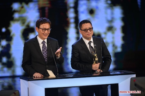 Director Sunny Luk (L) and Lok Man Leung recieve the Best Director award for their movie