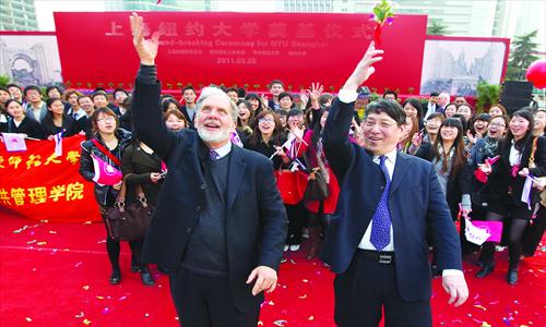 John Sexton (left), president of New York University (NYU) and Yu Lizhong, former president of East China Normal University and now president of NYU Shanghai, throw flowers to celebrate the groundbreaking ceremony of NYU Shanghai on March 28, 2011. Photo: CFP