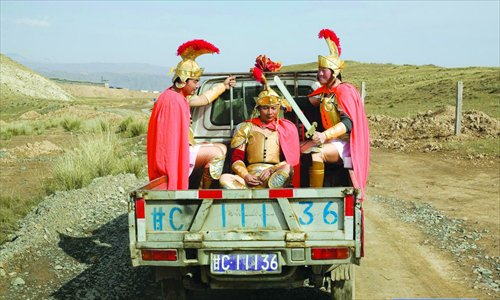 Villagers, dressed in armor, drive to a show. Photo: IC